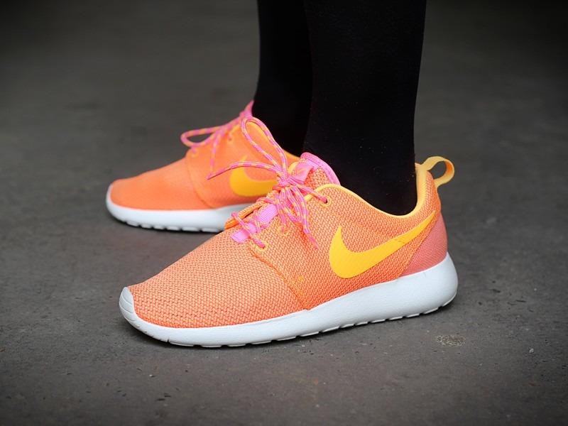pink and orange roshe runs